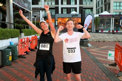 Two fun run participants celebrate at the finish line